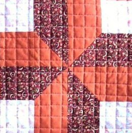 Quilted grid over patchwork avoiding seams.