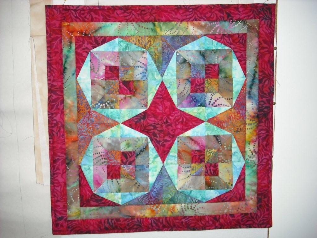 Brightly coloured patchwork design with circles
