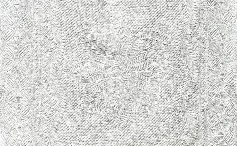 White hand quilted motifs