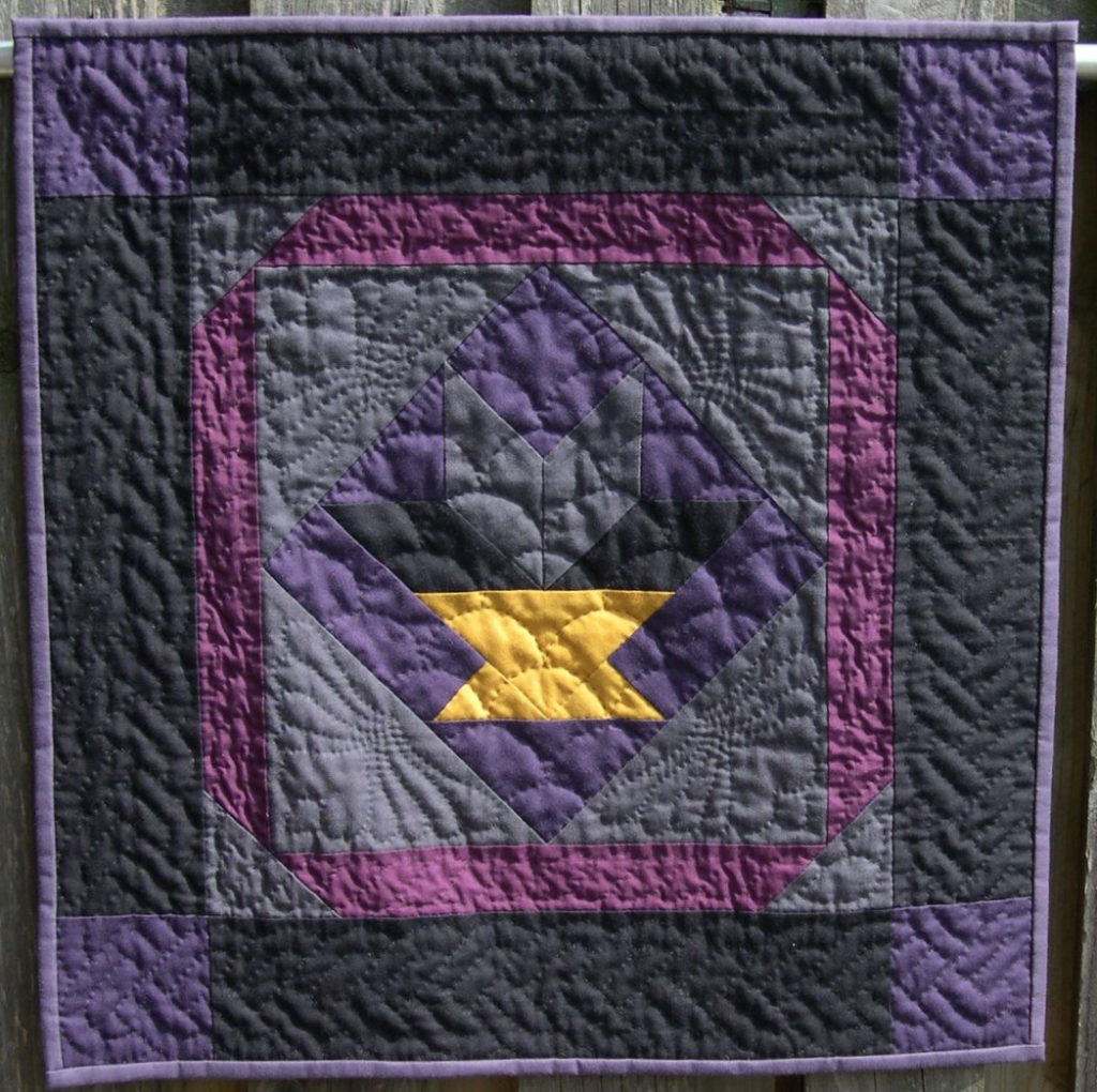 Black, purple and grey basket design with hand quilting