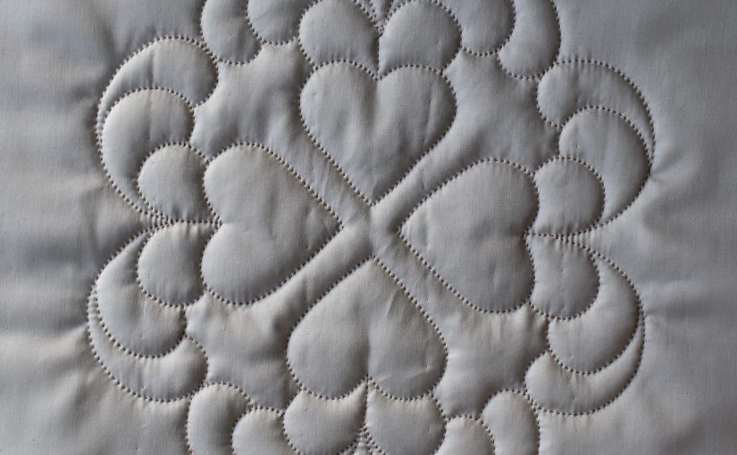 White quilted hearts design with deep texture