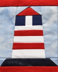 Red, white and blue pieced lighthouse