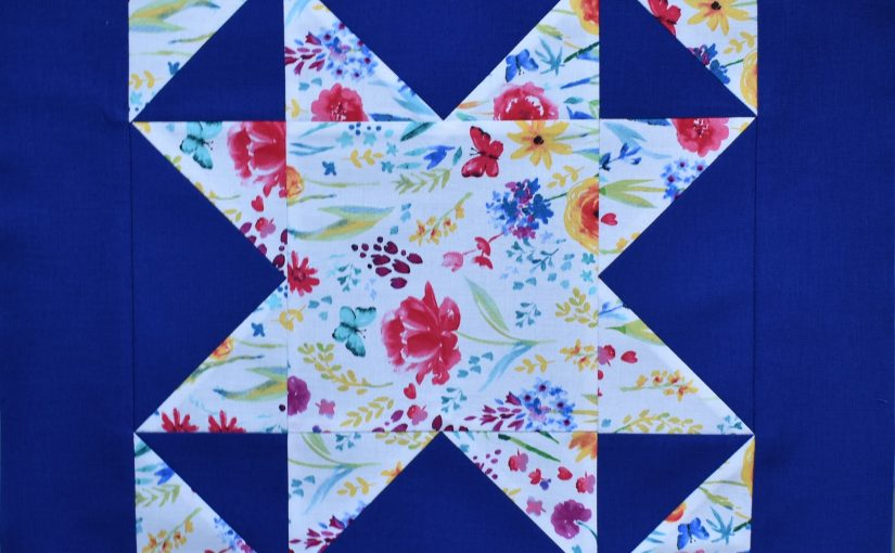 White patterned patchwork star on blue bakground