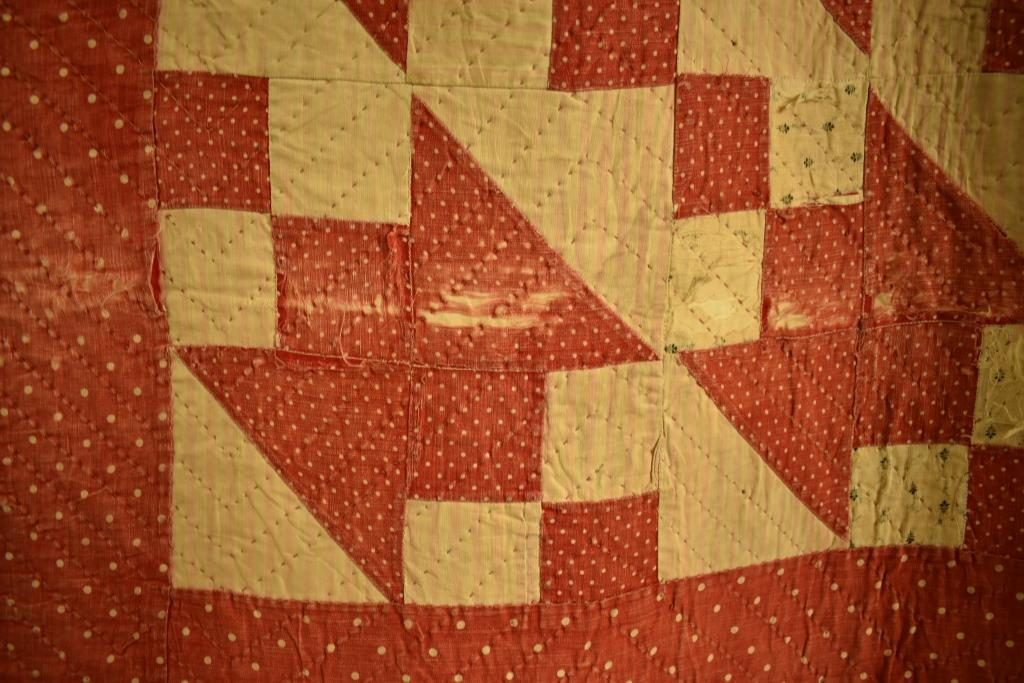Red and cream patchwork with zig-zag quilting