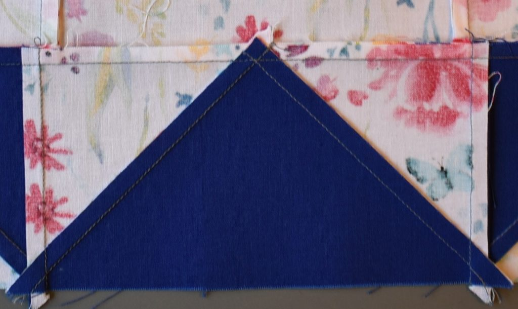 Patchwork with seam pressed away from large blue triangle