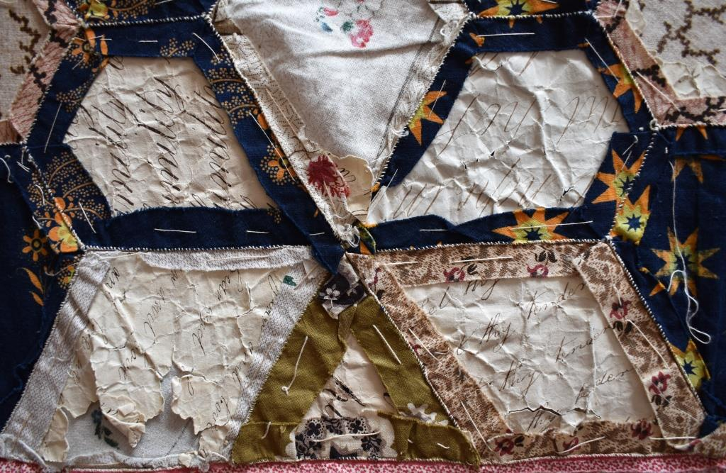 Patchwork seen from back, with paper templates still in