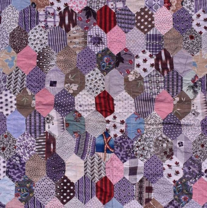 Patchwork hexagons in purples and other prints.