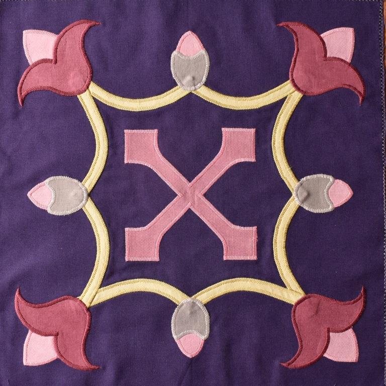 Pink Lily motifs set into a quatrefoil, on dark purple background