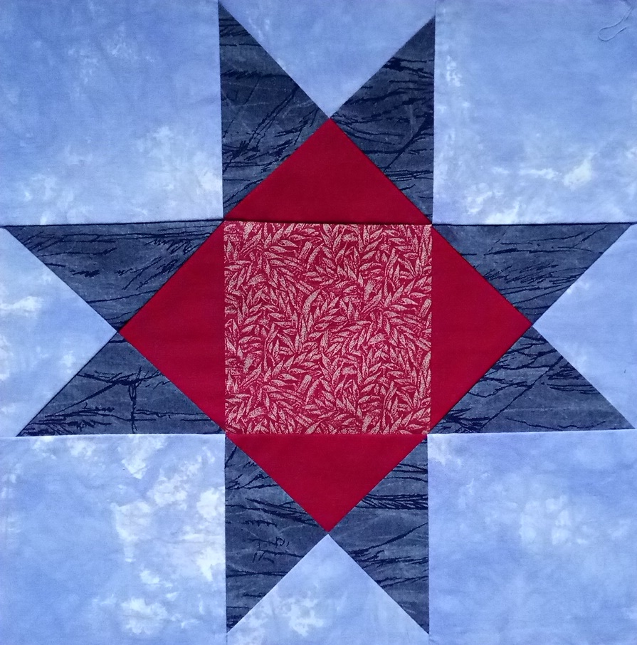 Blue and red Ohio Star block