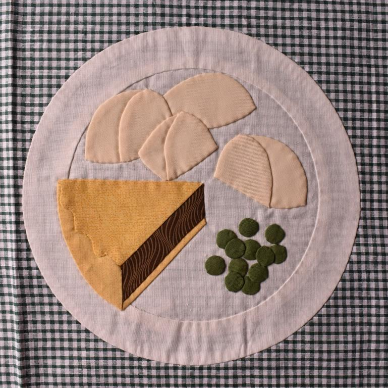 Pie, potatoes & peas on plate