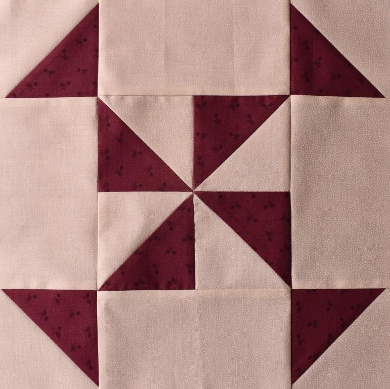 Dark red star on pink patchwork