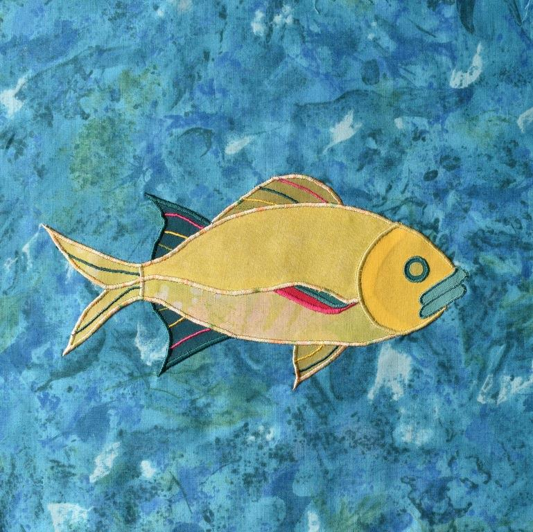 Yellow fish appliqued onto turquoise background