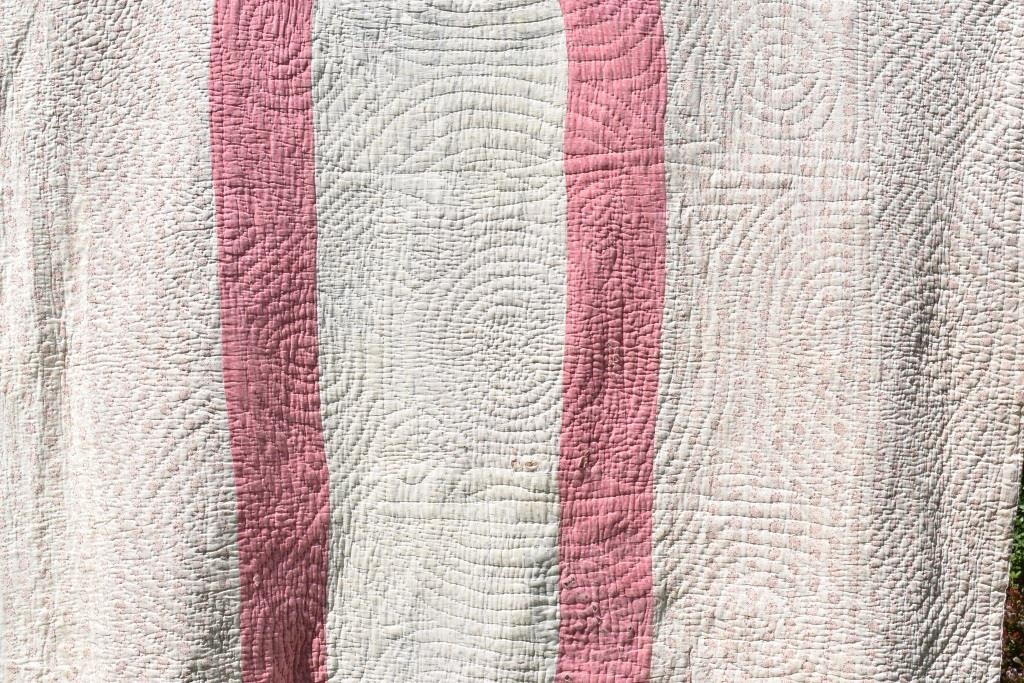 Pink and white fabric strips