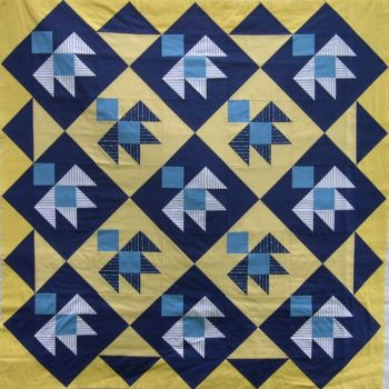 Patchwork birds in blue and yellow