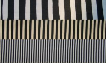 Three scales of black and white striped fabric