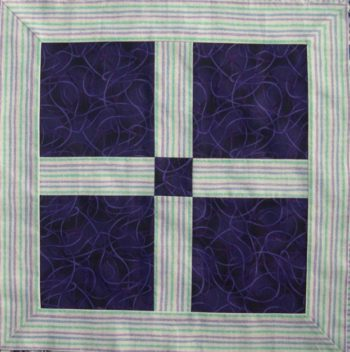 Purple square with stripy borders; stripes parallel to strip