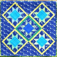 Patchwork stars on blue background